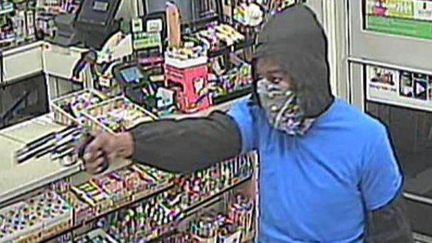 armed robber_1480806454463.jpg