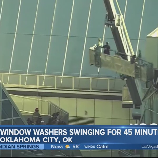 High-flying window washers get a wild ride!