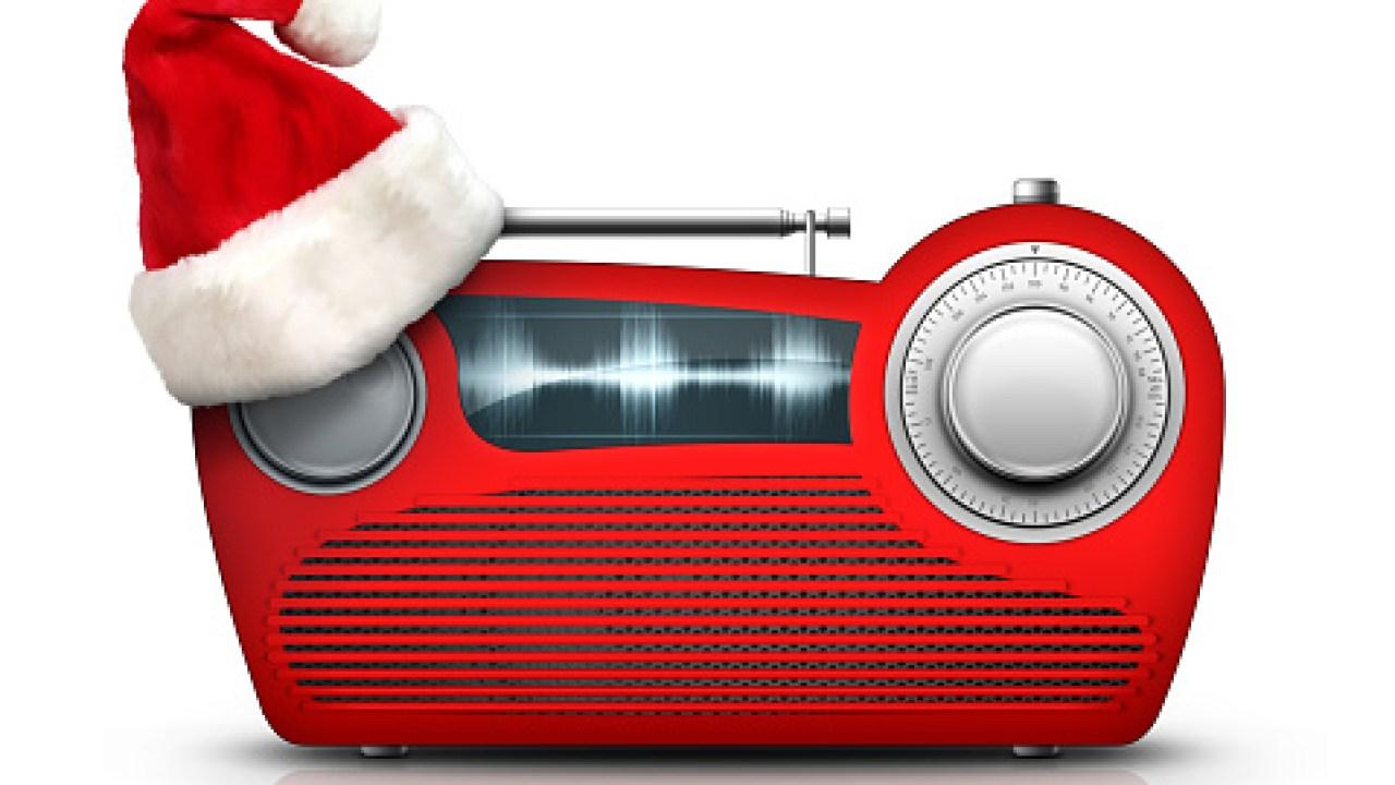 Christmas music rings through the
