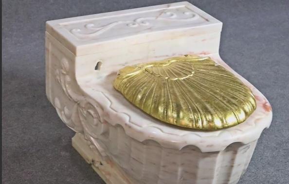 Frank Sinatra's golden toilets fetch thousands