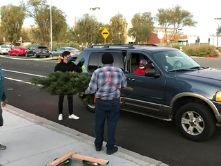 Metro teams up with Home Depot to donate Christmas trees to veterans